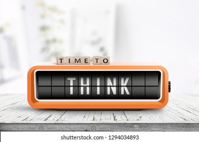 Time to think text on an old alarm clock in a bright room on a table