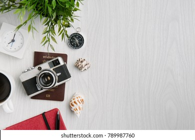 time to travel concept, wanderlust vacation background flat lay, space for text. camera sunglasses passport map phone on white wooden table. planning summer holiday