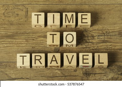 time to travel text on wooden cubes on a wooden background