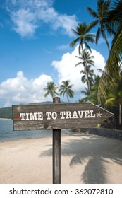 Time to Travel wooden sign with holiday background. Vertical composition.