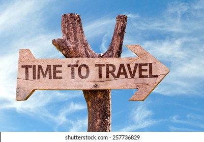 Time to Travel wooden sign with sky background