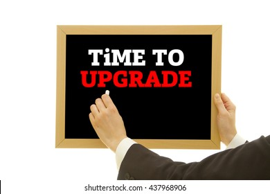 TIME TO UPGRADE message written on a small blackboard.