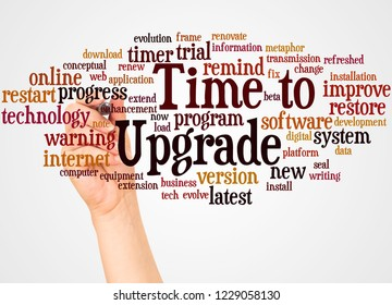 Time to Upgrade word cloud and hand with marker concept on white background.