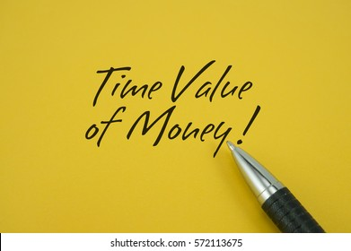 Time Value of Money! note with pen on yellow background
