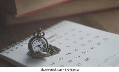 Time for Waiting with Vintage Pocket Watch on the Calendar and Wood Background ,Image for Deadline Time Concept