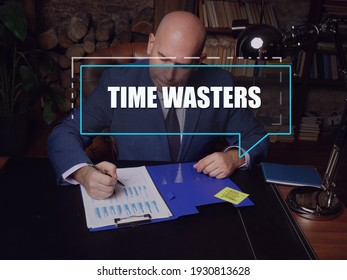 TIME WASTERS text in footnote block. Manager checking financial report A person who either consciously or unconsciously tries to engage you in a fruitless investment of your energy