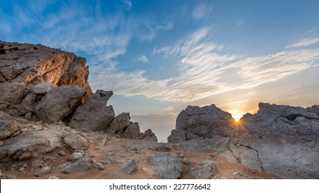 It is the time when the sun started to rise and show exactly at the edge of the rocks, amazing morning fossel Rock