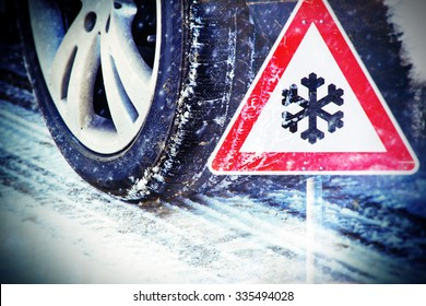 Time for winter tires - tire in winter with traffic sign