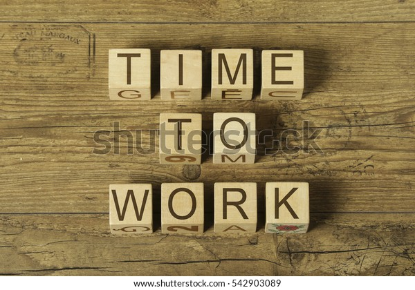 time to work text on cubes on wooden background