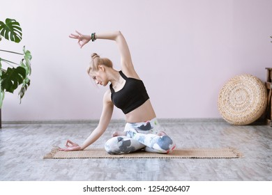 Time for yoga, wellness concept. Young woman exercising and sitting in yoga lotus position