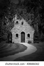A Timeless Stone Chapel at the End of a Curving Path in Black and White