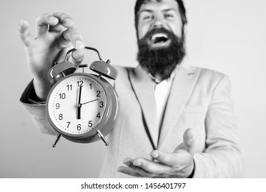 Timely concept. Hipster happy working day is over. Businessman finished on time. Time management skills. Best time of day. Just in time. Man bearded happy cheerful businessman hold alarm clock.