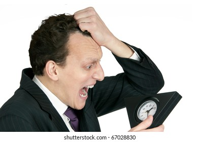 Time-management concept: business man looking at clock is shocked. Studio shot, isolated on white background