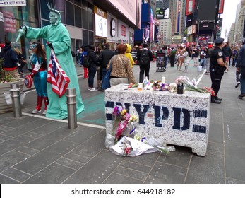 TIMES SQUARE, NEW YORK CITY, NY., USA, May 20, 2017: Scene of makeshift memorial fo car attack, killing one and injuring 20 people.