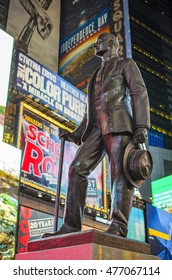 Times Square, New York - June 2016: Statue of famed showman George M. Cohan and huge outdoor billboards promoting Broadway musicals in Times Square.