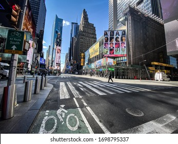 Times Square, New York, USA. March 24th, 2020.  Documentary photography of the empty streets in Times Square, New York during the lockdown caused by the Covid 19 / Corona virus.