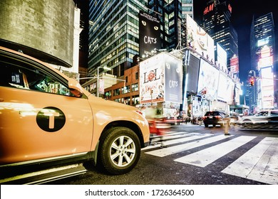 Times Square in New York, USA - 18 october, 2016:Yellow taxi car riding on the street