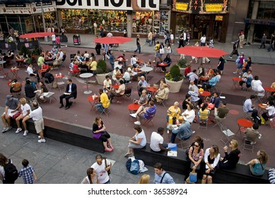 TIMES SQUARE, NYC - SEPTEMBER 2: Tourists and pedestrians enjoy the open space, tables and chairs due to the closing of Broadway to traffic between 42nd and 47th St September 2, 2009 in Times Square.