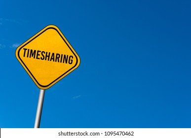 timesharing - yellow sign with blue sky