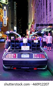 Timesquare, New York City - USA - JUNE 26, 2016: DMC De Lorean Back to the future car parking for show  under the ambient light at fifth avenue Timesquare, New York City - USA