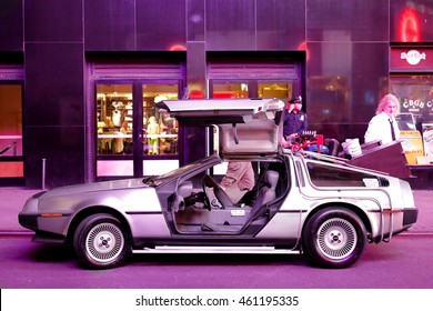 Timesquare, New York City - USA - JUNE 26, 2016: DMC De Lorean Back to the future car parking for show  under the ambience light at Fifth Avenue Timesquare, New York City - USA