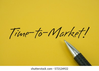 Time-to-Market! note with pen on yellow background