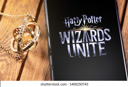 Time-Turner, smartphone with logo of Harry Potter: Wizards Unite - is a free game for augmented reality, based on locations, inspired by the Wizarding World. Moscow, Russia - May 16, 2019