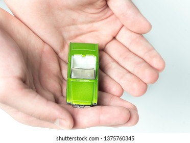 Time-worn car.Car  insurance and collision damage waiver concepts. Businessman with protective gesture