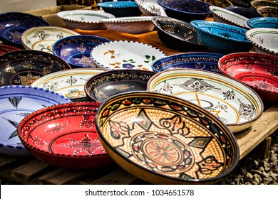 TIMGAD, ALGERIA - March 2017: Pottery market at Timgad, Algeria. Clay plates and bowls for sale on souvenir market, Algeria