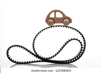 timing belt with toy car on a white background