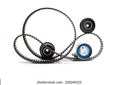 Timing belt, two rollers and the tension mechanism. Isolate.