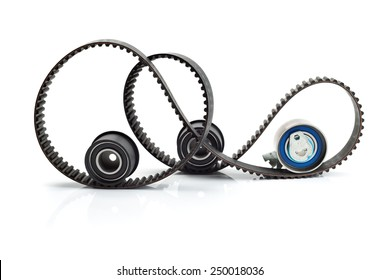 Timing belt, two rollers and the tension mechanism. Isolate on white background.