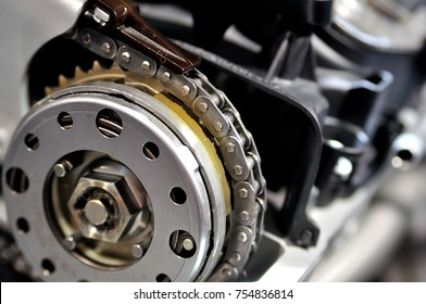 Timing chain on a drive wheel from a car engine.