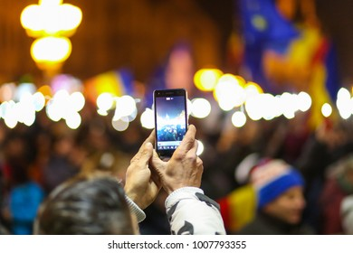 Timisoara, Romania - 01/20/2018 - Man recording with the phone camera the protests against laes of justice