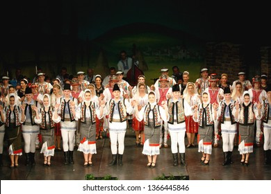 TIMISOARA, ROMANIA- 12. 10.2014 Professional dancers of the Banatul Folklore Ensemble hold hands in a traditional Romanian dance wearing traditional beautiful costumes.