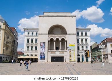 TIMISOARA, ROMANIA - CIRCA JULY 2017: Unidentified people walk through Victory Square past the Opera House
