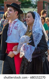 """TIMISOARA, ROMANIA - JULY 6, 2017: Couple from Portugal in traditional costume present at the international folk festival """"International Festival of hearts"""" organized by the City Hall."""