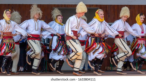 TIMISOARA, ROMANIA - JULY 7, 2019: Serbian dancers in traditional costume perform folk dance during International Festival of hearts, organized by the City Hall.