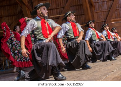 """TIMISOARA, ROMANIA - JULY 9, 2017: Dancers from Argentina in traditional costume perform at the international folk festival """"International Festival of hearts"""" organized by the City Hall."""