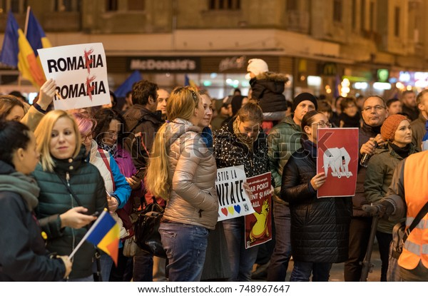 TIMISOARA, ROMANIA - NOVEMBER 05 2017: Group of protesters against Romanian Government. Protest took place in Opera Square in the city center.
