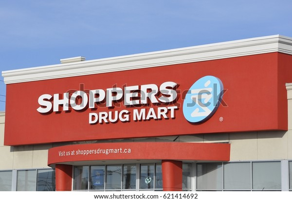 Timmins, Ontario, Canada - March 30, 2017: Signs of Shoppers Drug Mart in front of the store.