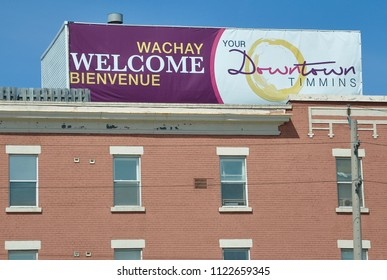 Timmins, Ontario, Canada - May 29, 2018: Sign of Welcome to Downtown Timmins seen on top of the building.