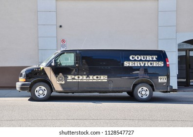 Timmins, Ontario, Canada - May 30, 2018: Timmins police court service van seen park outside the building.