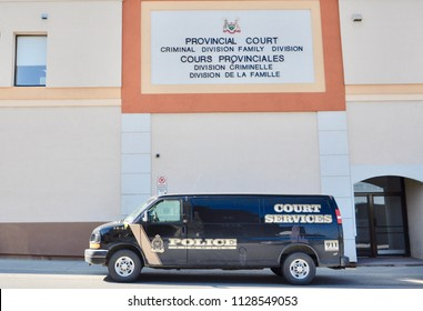 Timmins, Ontario, Canada - May 30, 2018: Timmins police court service van seen parked outside the provincial court building.