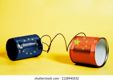 tin can phone with China and European Union Flag .communication concept on yellow