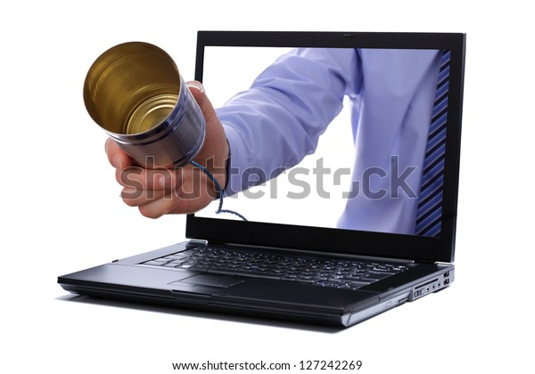 Tin can telephone through laptop screen concept for internet phone or voice over ip