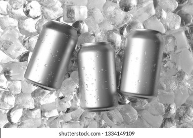 Tin cans on ice cubes, flat lay