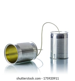 Tin cans telephone on white background