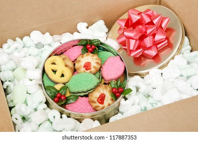 A tin of Christmas cookies being shipped by mail.