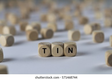 tin - cube with letters, sign with wooden cubes
